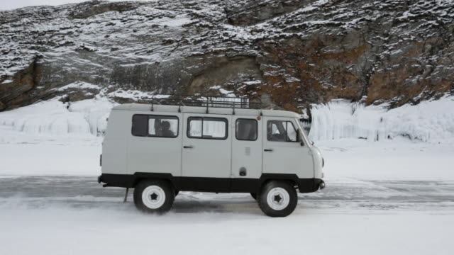 russian suv rides on the ice of lake baikal - sports utility vehicle stock videos and b-roll footage
