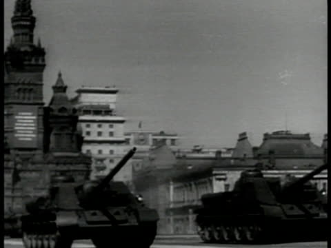 Russian T34 tanks in parade Red Square Moscow State Historic Museum BG VS T34 Armored tanks driving by in May Day Parade Soviet Union Communist...