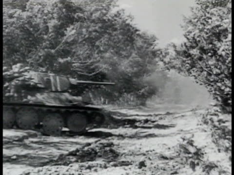russian tanks moving through woods clearing russian soviet soldiers riding on exterior tank vs tanks moving into battle firing guns soldiers jumping... - battle stock videos & royalty-free footage