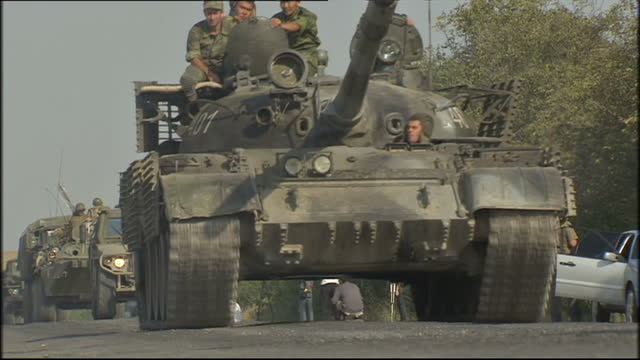 Russian troops in the South Ossetia region Shows exterior shots Russian T62 tank convoy and other military vehicles driving along road on August 20...