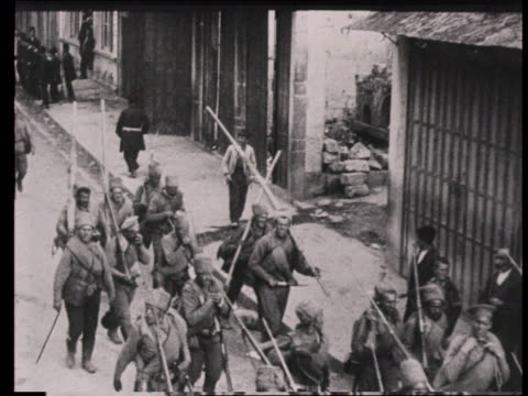 stockvideo's en b-roll-footage met russian troops marching through city streets during ww i soldiers dismounting sign above entrance door to us consulate / trabzonturkey - 1915