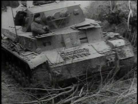 russian troops moving through woods / soviet tank fording stream / troops remove brush from artillery / artillery firing / shells exploding - 1941 stock-videos und b-roll-filmmaterial