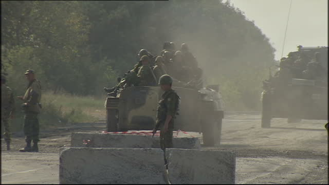 vídeos y material grabado en eventos de stock de russian troops patrolling the south ossetia region. shows exterior shots russian troops using apc and driving through checkpoint. on august 20, 2008... - georgia