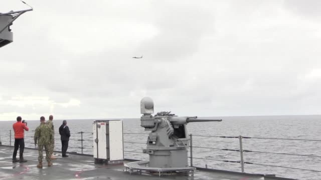 a russian tupolev tu142 maritime patrol aircraft flies past the us command ship the uss mount whitney as it takes part in nato's trident juncture 18... - norwegian sea stock videos & royalty-free footage