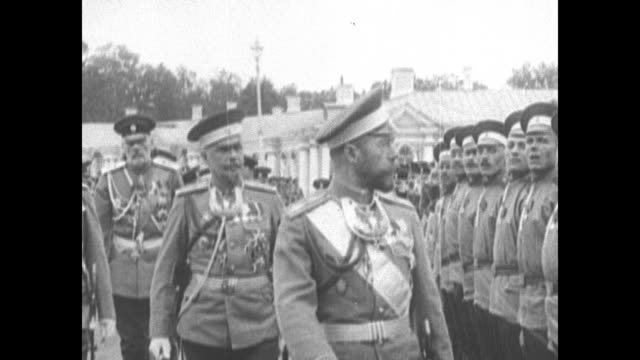 russian tzar of russia nicholas ii revues a line of troops accompanied by bemedaled officers - 1910 stock-videos und b-roll-filmmaterial