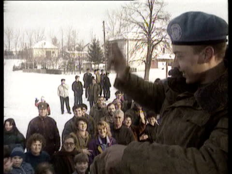 russian un troops arrive in the serbianheld town of pale / warm welcome from locals for russian un troops arriving in un trucks and armored personnel... - anno 1994 video stock e b–roll