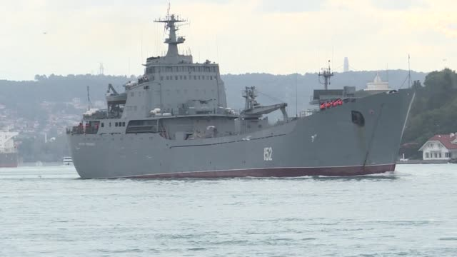 russian warship coming from sebastopol in crimea crosses the bosphorus in istanbul heading to tartus in syria - warship stock videos & royalty-free footage