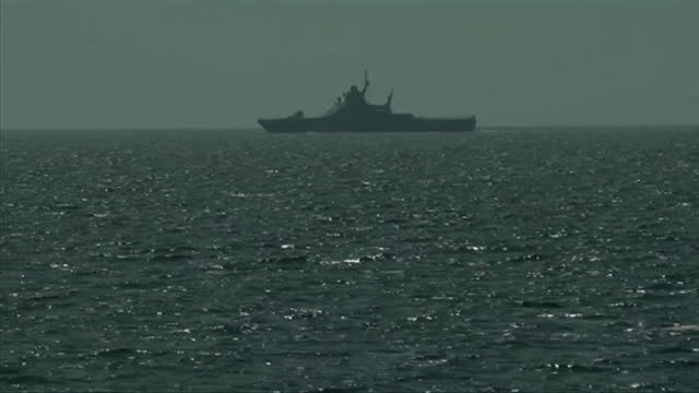 russian warships and coastguard shadow british warship, hms defender, sailing off the coast of crimea in the black sea, due to a dispute over... - forze armate britanniche video stock e b–roll