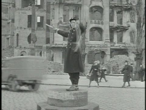 russian woman in uniform standing on platform directing traffic bombed buildings bg tu ms street signs in russian cyrillic lettering - directing stock videos and b-roll footage