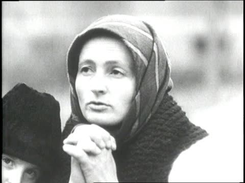 vídeos y material grabado en eventos de stock de a russian woman prays and kisses her two children - ruso europeo oriental