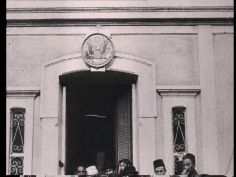 stockvideo's en b-roll-footage met russianamerican fraternization of armenian refugees during ww i people holding american flags standing in american embassy garden and at gates... - 1915