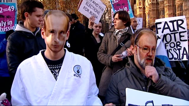 russians in london protest against vladimir putin over alleged election fraud england london westminster ext various shots of anitputin protesters... - corporate theft stock videos and b-roll footage