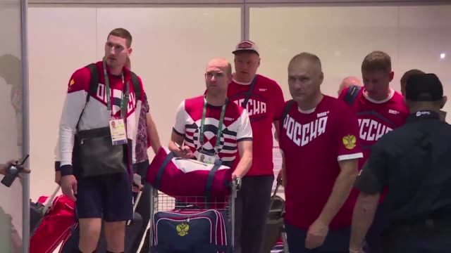 vídeos de stock, filmes e b-roll de russias olympic team arrives in rio de janeiro from moscow on thursday night after the ioc declined to impose a blanket ban after evidence of state... - rio russian