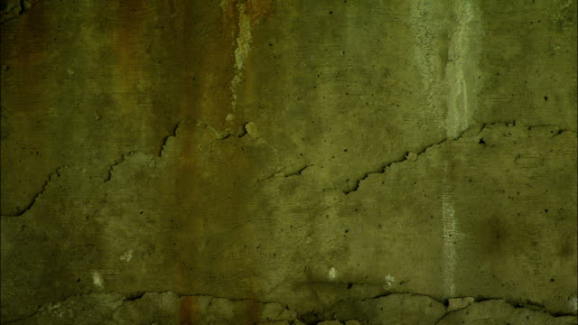rust and cracks show on a concrete structure. - concrete stock videos & royalty-free footage
