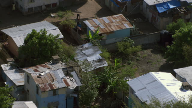 rust covers the roofs of the buildings in the slums of  kingston, jamaica. - jamaica stock videos & royalty-free footage
