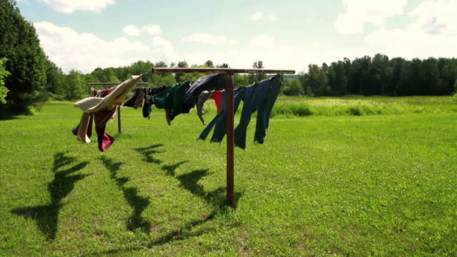 rustic clotheslines in a field - washing line stock videos & royalty-free footage