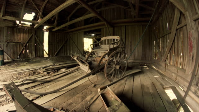 rustic farm equipment in abandoned barn - cart stock videos & royalty-free footage