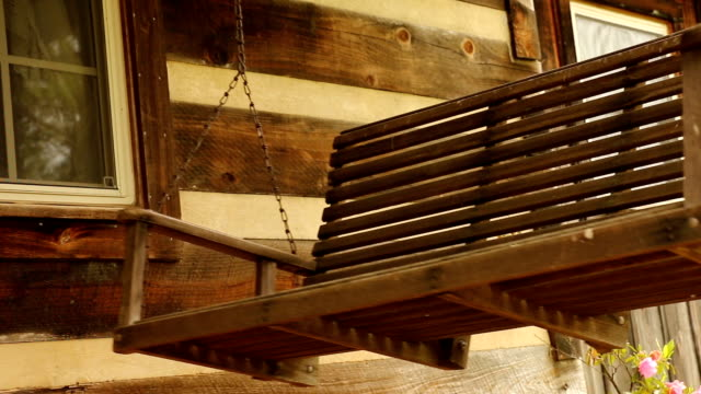 rustic log cabin wooden porch swing - outdoor chair stock videos & royalty-free footage