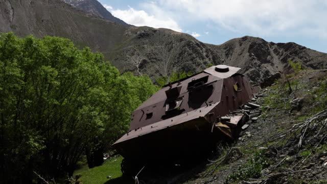 a rusty, abandoned machinery on a hill - portello video stock e b–roll