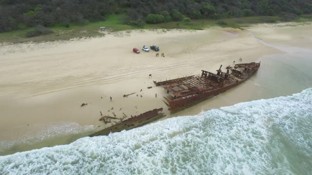 rusty boat and mountains on beach - imperfection stock videos & royalty-free footage