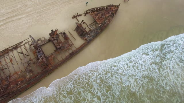 rusty boat on shore with waves - imperfection stock videos & royalty-free footage