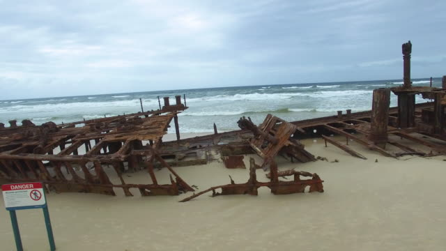 rusty boat washed up on shore - imperfection stock videos & royalty-free footage