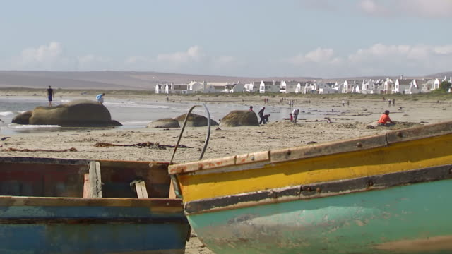 ms rusty boats on beach with people enjoying at beach / western cape, south africa - imperfection stock videos & royalty-free footage