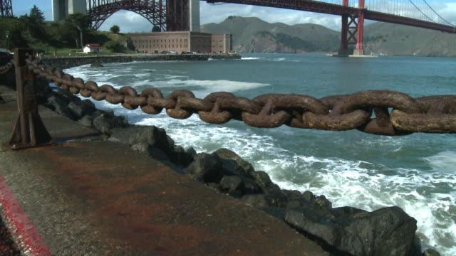 CU, TU, WS, Rusty chain along shore and Golden Gate Bridge, San Francisco, California, USA