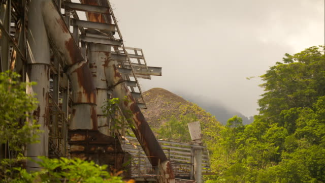 rusty mining structure remains at site of former panguna copper mine on bougainville island papua new guinea - abandoned stock videos & royalty-free footage