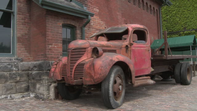 ms pan rusty old antique pick up truck in historic distillery district / toronto, ontario, canada - distillery stock videos and b-roll footage