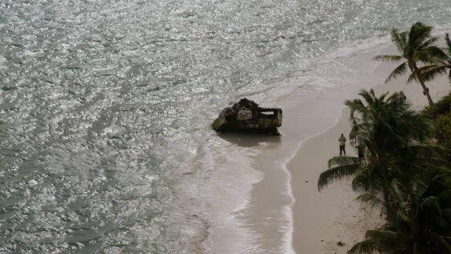ws aerial pov rusty sherman tank on flamenco beach / culebra, puerto rico, united states - flamenco stock videos and b-roll footage