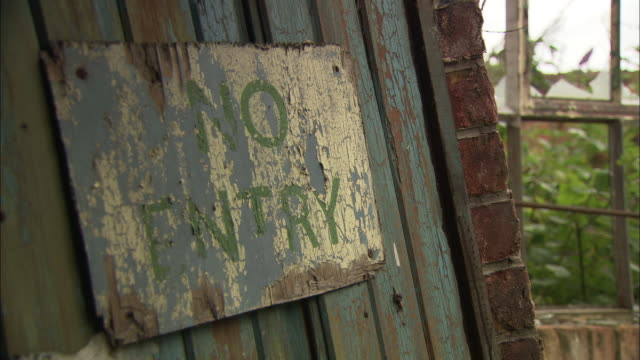 A rusty sign reads No Entry.