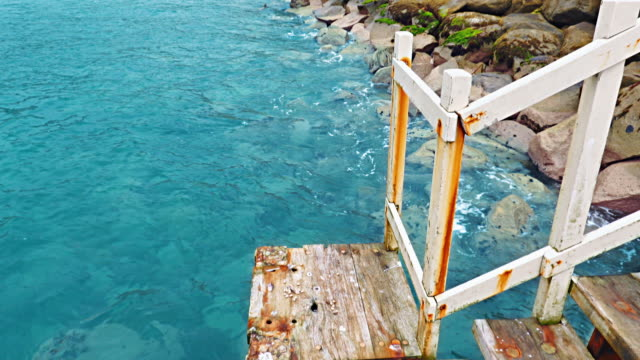 rusty stairway to the sea - weathered stock videos & royalty-free footage