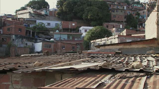 ws rusty tin roofs of clustered homes in petare / caracas, miranda, venezuela - caracas stock videos & royalty-free footage