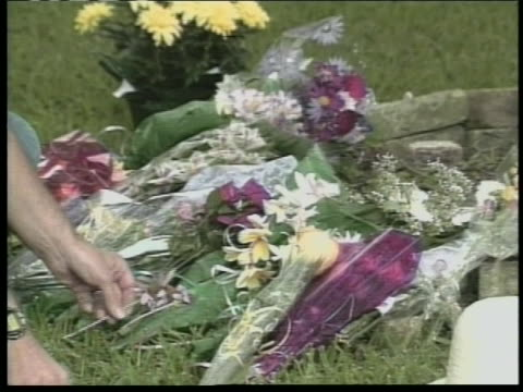 rusty yates holds and looks at flowers outside his house on the memorial for his children that were drowned by his wife, andrea yates. she was... - postpartum depression stock videos & royalty-free footage