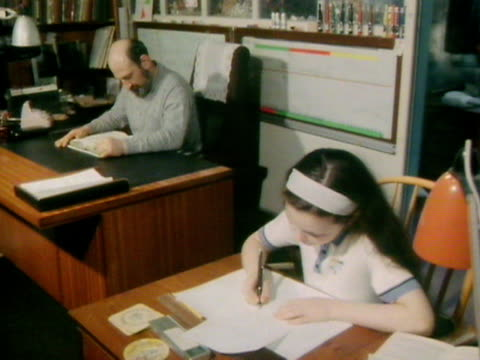 ruth lawrence and her father work at desks in their home study - desk stock videos & royalty-free footage