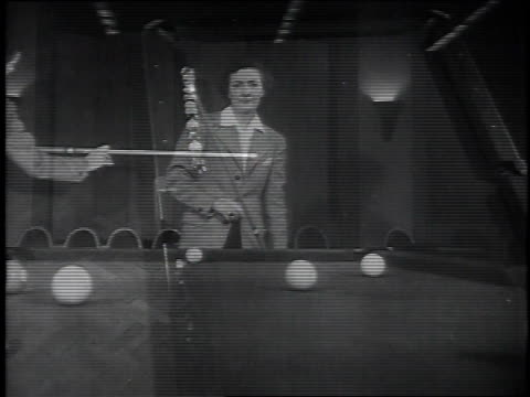 ruth mcginnis playing pocket billiards / balls after break/ sinking pool balls into side pocket / trick shots of various combinations / ruth looking... - pool cue sport stock videos & royalty-free footage