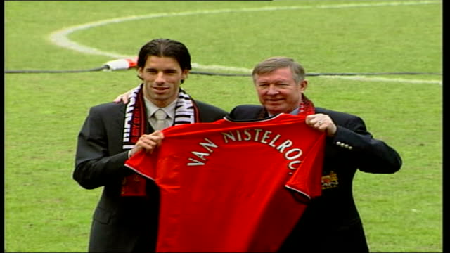 Ruud Van Nistelrooy signs for Manchester United ITN Manchester Old Trafford Van Nistelrooy Ferguson walking across pitch both stand hold up...
