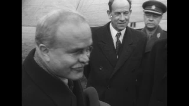 honor guard waits in formation / soviet foreign minister vyacheslav molotov deplanes greeted by officials / he shakes hands with czech deputy prime... - vyacheslav m. molotov stock videos and b-roll footage