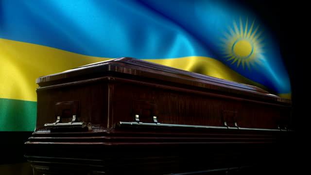 rwanda flag behind coffin - war crimes trial stock videos & royalty-free footage
