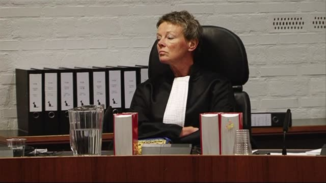 a rwandan woman turned dutch national went on trial in a hague court on monday charged with genocide for her alleged role in the 1994 massacre of... - legal trial stock videos & royalty-free footage
