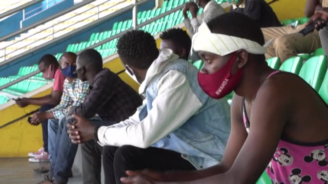 stockvideo's en b-roll-footage met rwandans caught breaking curfew or not wearing masks are being sent to stadiums in droves for allnight lectures on the dangers of coronavirus as the... - {{asset.href}}