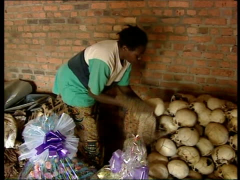 rwanda's genocide ten years on itn int gv church where tutsis were murdered now empty gv skulls woman cleaning skulls woman interview sot they hacked... - völkermord stock-videos und b-roll-filmmaterial