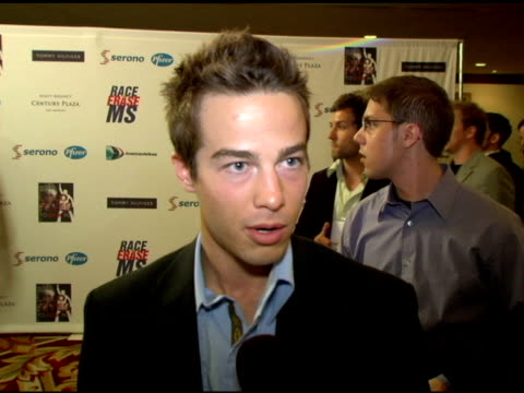 vídeos y material grabado en eventos de stock de ryan carnes on modeling in the tommy hilfiger show, what he?s wearing, acting vs modeling at the 13th annual race to erase red carpet at hyatt... - race to erase ms