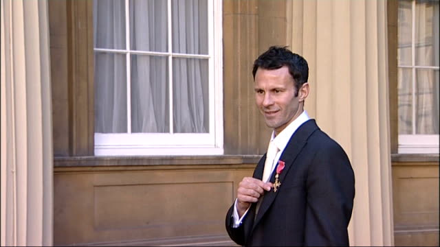 ryan giggs holds first press conference as manchester united interim manager lib buckingham palace ryan giggs posing for photocall with obe medal... - order of the british empire stock videos and b-roll footage
