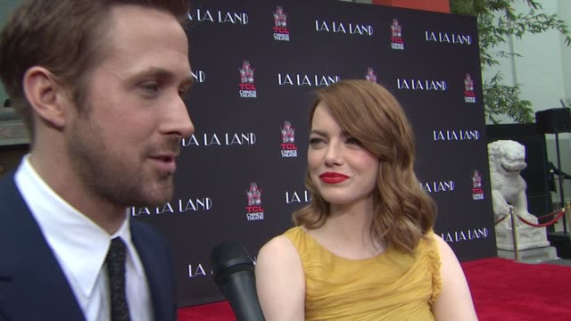 interview ryan gosling and emma stone on how much of an honor it is to have your hand and foot prints displayed at this iconic venue on how special... - ryan gosling stock videos and b-roll footage