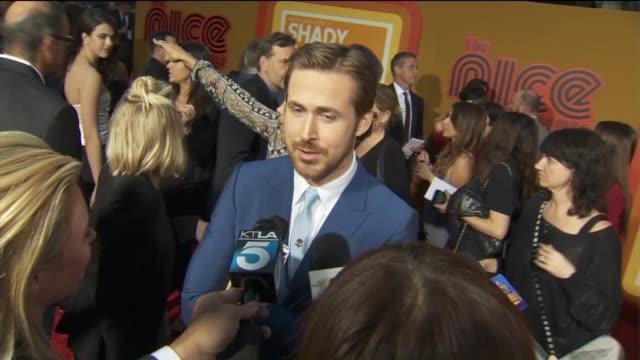 ryan gosling talks about 'the nice guys' film at premiere. - ryan gosling stock videos & royalty-free footage