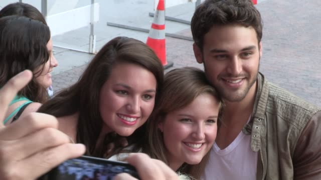 ryan guzman greets fans at the red 2 premiere at westwood village in los angeles, 07/11/13 - westwood village stock videos & royalty-free footage