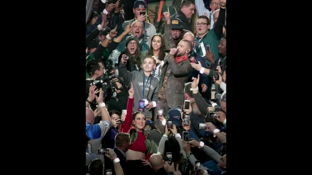 Ryan McKenna takes a selfie as recording artist Justin Timberlake performs during the Pepsi Super Bowl LII Halftime Show at US Bank Stadium on...