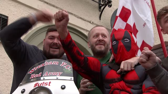 ryan reynolds and rob mcelhenney secure takeover of wrexham afc; wales: wrexham: ext various shots of wrexham fans chanting stood around / sat on... - scooter stock videos & royalty-free footage